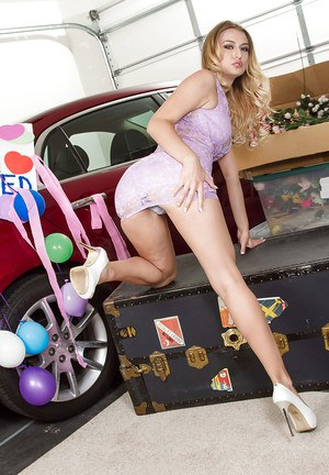 Next to a new car young Euro babe Natalia Starr displays her fine body