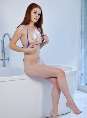 Barely legal redhead hottie Alice Green masturbates in a hot bath