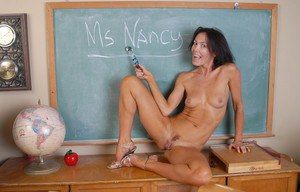 Aged teacher Nancy spreads her legs and dildoes her shaved mature cunt