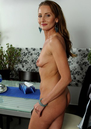 Horny older chick Michelle Gaia gets naked in the dining room