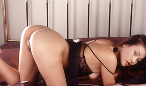 Utilizing a dildo an Asian MILF hottie gives herself orgasmic bliss
