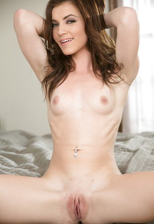 Teen hottie Emma Stoned shows off her piercings and small breasts