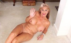 Older lady Rae Hart baring her overly large mature woman's breasts