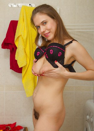 Amateur chcik Agnea playing with her saggy boobs in the bathtub