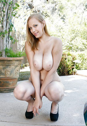 Busty babe Alexia Rae showing off her big melons in the great outdoors