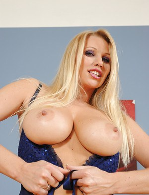 Sexy blonde babe Busty shows off her huge knockers and bald slit