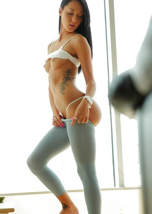 Horny babe Sabrina Banks removes her gym clothes and strokes herself