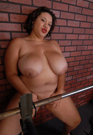 Older busty BBW Monet finishes her workout by undressing in the gym