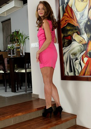Hot older dame Michelle Gaia posing in pink dress and high heels