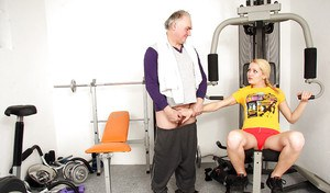 Young fitness chick in pigtails sucks off a much older man's cock