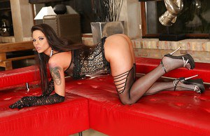 Brunette doll Simony Diamond looking sultry in black lace gloves