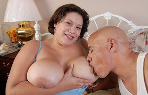 Experienced fat chick Monet holding big tits during pussy eating