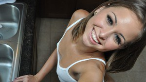 Adorable teen girl Riley poses while showing off her naked round rump