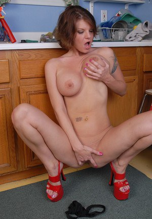 Experienced temptress Kayla teases with her curvy body in the kitchen