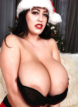 Sexy topless Christmas photo shoot with busty brunette Leanne Crow