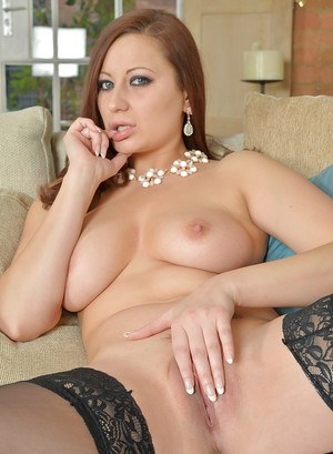 Busty MILF Lara Jade Deene hops on the couch and shows her naked body