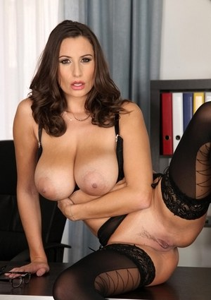Brunette boob model Sensual Jane gets undressed at the office