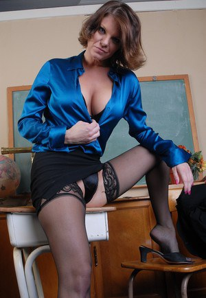 Older lady Kayla takes off blouse and spreads in sexy black lingerie