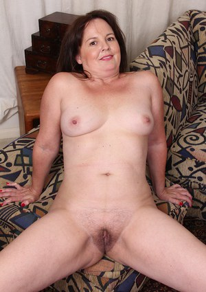 Mature BBW Felicia McDonald spreads her hairy cunt lips wide