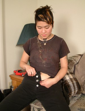 Amateur Asian chick Cady removes sexy boots and bares hairy cooter