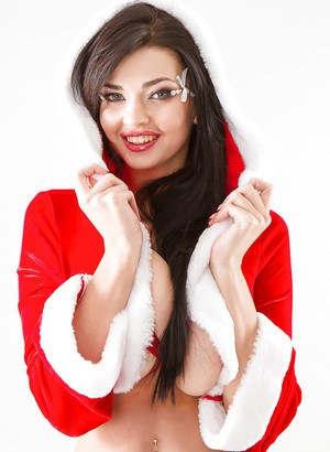 Buxom Euro babe Sha Rizel lets her massive hooters loose for Christmas