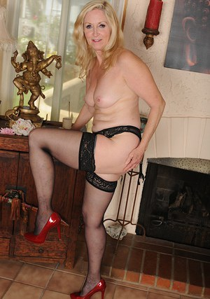 Older blonde lady Annabelle Brady posing in high heels and lingerie