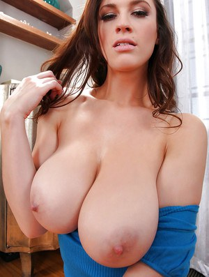 Big tit model Lana Kendrick unleashes her impressive natural breasts