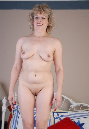 All natural older blonde Crystal plays with her boobs and bald vagina