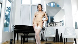 Brunette pornstar Vicki Chase poses in stockings and high heels