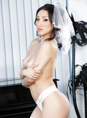 Asian pornstar Vicki Chase strikes sexy pose in wedding dress