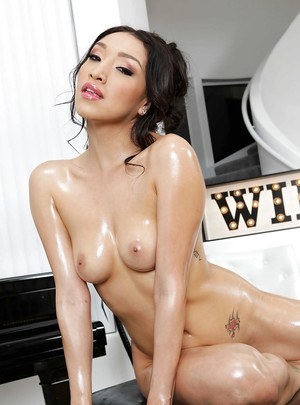 Sexy Oriental MILF Vicki Chase plays with her oiled big breasts