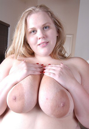 Blond SSBBW Christina undresses and flashes bald cunt and massive tits
