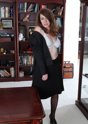 MILF over 40 Joanie Bishop is a sexy secretary in pantyhose and skirt