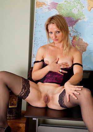 Hot older blond Trinity gets naked at work and plays with spread twat