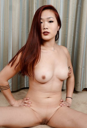 Oriental MILF Lea Hart shows off her freshly shaved Asian pussy