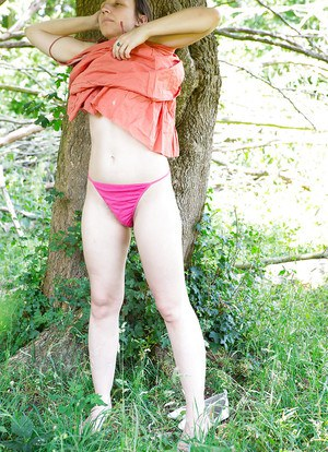 Outdoor shots of amateur chick Remie dressing her hairy pussy