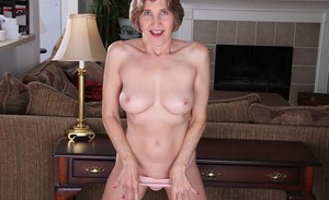 Horny mature woman Bossy Ryder posing in her sexy granny panties