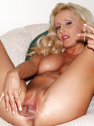 Busty blond Euro Zora Banks flaunts her hot mature figure in teh nude