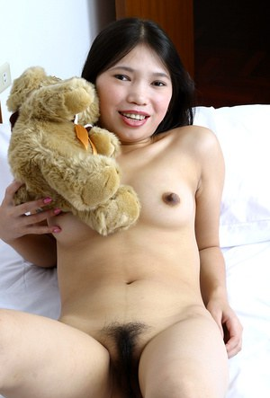 Ugly Asian amateur Diep showing off her tiny tits and hairy pussy