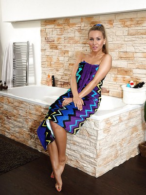 Amateur blonde Whitney Conroy playing with homemade toys in her bathtub