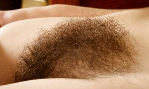 Older hairy woman Sunshine strips off skirt for hairy muff close ups