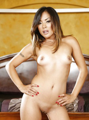 Oriental MILF Kaylani Lei showing her tiny tits and shaved pussy