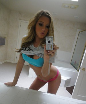 Young blonde Samantha Saint taking nude selfies in the bathroom