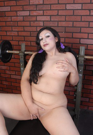 BBW Terina stripping naked after sports workout and masturbating bald pussy