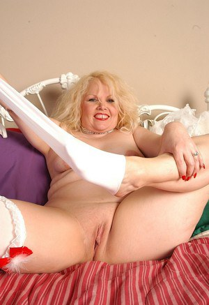 Mature blonde plumper Sunshine stripping off sexy white lingerie