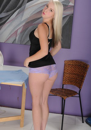 Beautiful teener Darcie Bells stripping off skirt and panties
