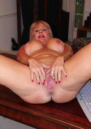 Over 50 MILF Rae Hart fondling big breasts and parting shaved granny twat