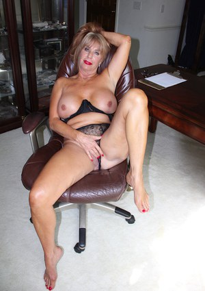 Busty MILF over 50 Rae Hart getting naked and rubbing pink pussy