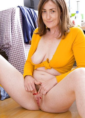 Hairy first timer Ensa strips off shorts and pantyhose to play with labia
