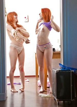 Cute redheads Carmina and Uma J pull panties up over asses after dyke sex
